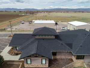 top view of commercial building with black asphalt shingle roofing