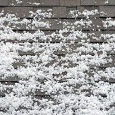 Asphalt shingle roof with hail on it