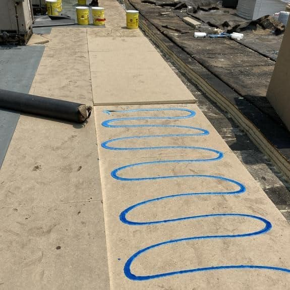 Fort Collins Chamber of Commerce roof low rise adhesive being applied