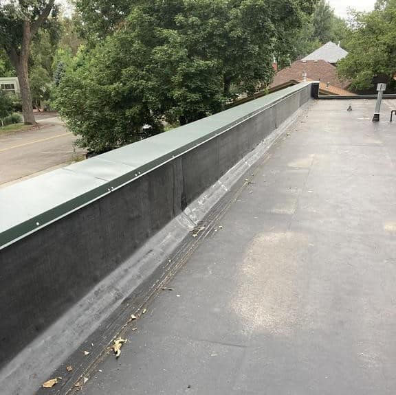 Fort Collins Chamber of Commerce completed roof with new coping on perimeter