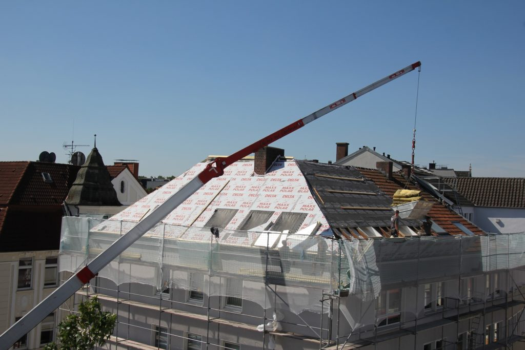 Commercial Roofing contractors installing a roof